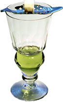 Traditional Melting Spoon and Sugar Cube Over Glass of Absinthe