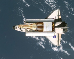 The Space Shuttle Discovery orbiting Earth, with a payload of Schramsberg sparkling wine