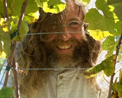 Didier Dagueneau surrounded by grape leaves