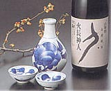 A bottle of sake and serving ware
