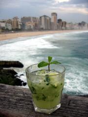 Leblon Cachaca caipirinha cocktail prepared on Leblon Beach in Rio de Janeiro, Brazil